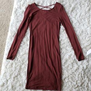 Long sleeved cross back dress